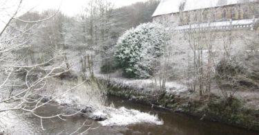 The River Calder as it flows past Copley Church