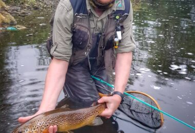 Jonathan Hoyle with big wild river trout